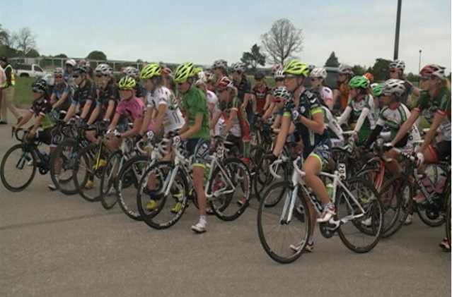 TIBCO in the pink, green and white jerseys on the start of stage 3